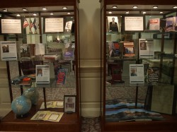 The display is located to the right of the reference desk as you enter the Library.