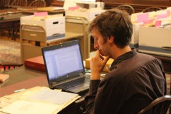 Dr. Maiden examining the Dennis Bennett papers in Special Collections.