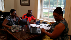 Ed.D. student Sharon Gardner (right) and guest scholars make full use of the new electrical and USB ports.