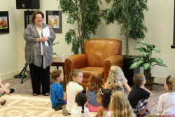 Sara Baron addressing enthusiastic young library users at the 2014 Regent Reads summer festival of children's literature.