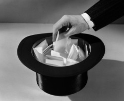 1930s man's hand in top hat full of paper pulling name out of hat